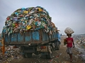 A man is go to market for selling collected materials and another waste carrying trucks are entering. The permanent Waste land under Sylhet City Corporation. Lalmatia, Sylhet, Bangladesh